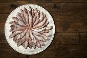 stock photo of mullet  - Fresh fish mullet in a plate on wooden table - JPG