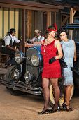pic of gangster necklace  - Serious 1920s Hispanic women with gloves near vintage car