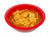 A Serving Of Ravioli In A Red Bowl