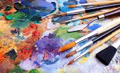 stock photo of paint palette  - artists brushes and oilpaints on wooden palette - JPG