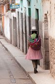 Quechua Woman Walking The Streets Of Calla, Peru