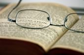 image of revelation  - A bible open to the book of Revelation with glasses on top - JPG