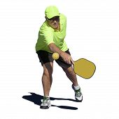 stock photo of pickleball  - Isolated digital image of a senior man hitting a backhand stroke during a pickleball match - JPG
