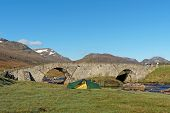 Tent By Spey River At Garva Bridge, Scotland In Spring