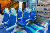 DUBAI, UAE - 31 MARCH 2014: Metro line interior in Dubai, UAE. The Dubai Metro is a driverless, full