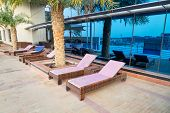 ABU DHABI, UAE - 31 MARCH 2014: Pool area of The Grand Midwest Tower Hotel in Dubai, UAE. The Grand