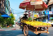 VIENTIANE, LAOS - 11 DEC,2013: Unidentified street vendor sells bananas in downtown of Laotian capit