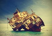 stock photo of shipwreck  - The sunken shipwreck on the reef Egypt vintage retro filtered - JPG