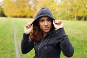 Confident Female Athlete In Hoodie