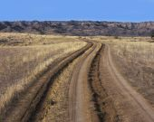 Tire track and ruts in a dirt road