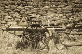 stock photo of charioteer  - an old chariot against an ancient wall - JPG