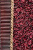 Dried Cranberries Lying On Dark Bamboo Mat, For Menu