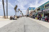 LOS ANGELES, CALIFORNIA - June 20, 2014:  Shops and tourists on the famously funky Venice Beach board walk in Los Angeles.