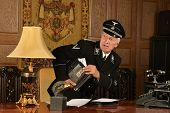 stock photo of snuff  - German spy stealing important documents from the office - JPG
