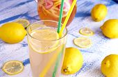 Pitcher of lemonade with lemons, and fresh