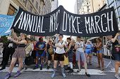NYC Dyke March banner advances on Fifth