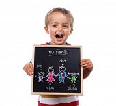 Young child holding my family chalk blackboard sign standing against white background