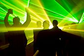 picture of rave  - lasers at a nightclub and silhouettes of dancing people - JPG