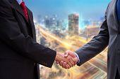 Handshake On Background Of Buildings
