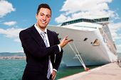 foto of cruise ship caribbean  - a Young smiling man show the Cruise Ship - JPG