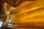 Reclining Buddha Gold Statue In Wat Pho Buddhist Temple, Bangkok, Thailand