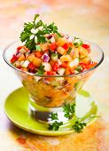 Fresh melon salsa with red pepper and cucumber