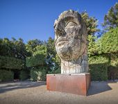 stock photo of garden sculpture  - Sculpture of head in Boboli Gardens near Pitti palace, Florence Italy