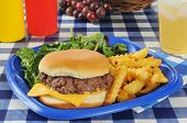 Cheeseburger With Fries On A Picnic Table