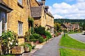 stock photo of broadway  - Pretty cottages along High Street Broadway Cotswolds Worcestershire England UK Western Europe - JPG