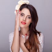 Beautiful Brunette With Flowers In Head And Red Lipstick