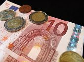 Euro bank note and coins