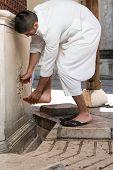 Muslim Washing Feet Before Entering Mosque