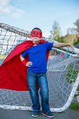 Superhero Leaning On Football Goal