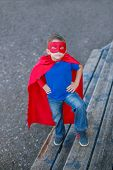 Superhero Standing With Hands On Hips And Looking Up