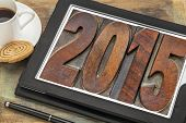 2015  - New Year concept  - isolated text in vintage wood type printing blocks on a digital tablet with a cup of coffee