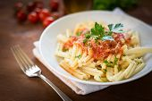 stock photo of italian parsley  - dish of italian pasta topped with tomato sauce and parsley - JPG