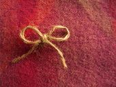 Cute twine bow on Irish wool.