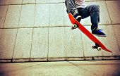 stock photo of skateboarding  - young asian woman skateboarder skateboarding at city - JPG