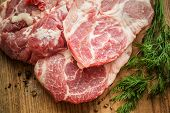Close up Raw Fresh Meat Slices on Wooden Chopping Board. Ready for Cooking Main Dish
