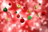 Digitally generated hanging christmas decorations against digitally generated twinkling light design