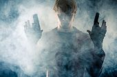 image of pistols  - manly hero with pistols in hands in the smoke - JPG