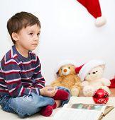 Cute Boy Reading A Fairy Tale. New Year