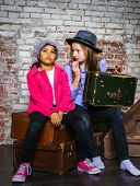 Two girls on brick wall background