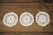 Three White Round Place Mat In A Row