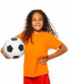 Little African girl holding soccer ball isolated