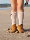 Detail Of Little Girl Boots On The Beach Outdoors