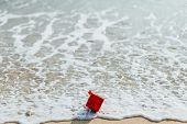 Gift Red Box In The Sea