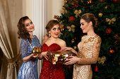 fashion women exchanging gifts