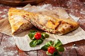 Calzone - Stuffed Pizza with Tomato, Mozzarella and Ham
