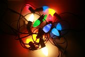Light up Retro or Vintage Style Holiday Lights on white. 1950's era large bulb colored Christmas lights, in the colors of Red, Blue, Green, Yellow, Orange and Turquoise